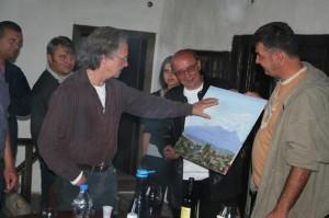 Peter Handke receiving a painting at The Bells Of Metohija, Velika Hoca 2009